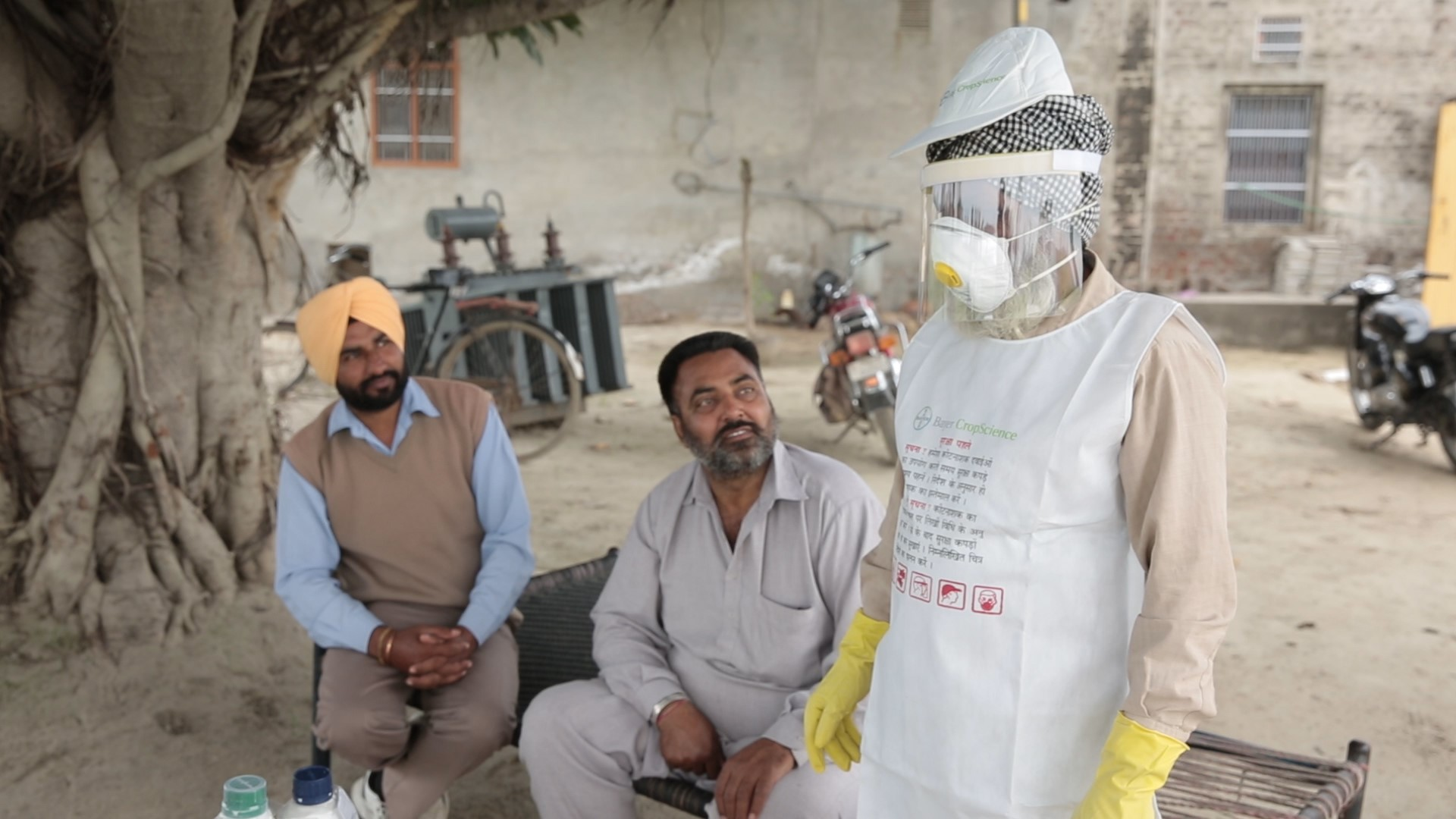 Appropriate PPE being demonstrated to farmers in India by Bayer CropScience (ECCHR, 2015)