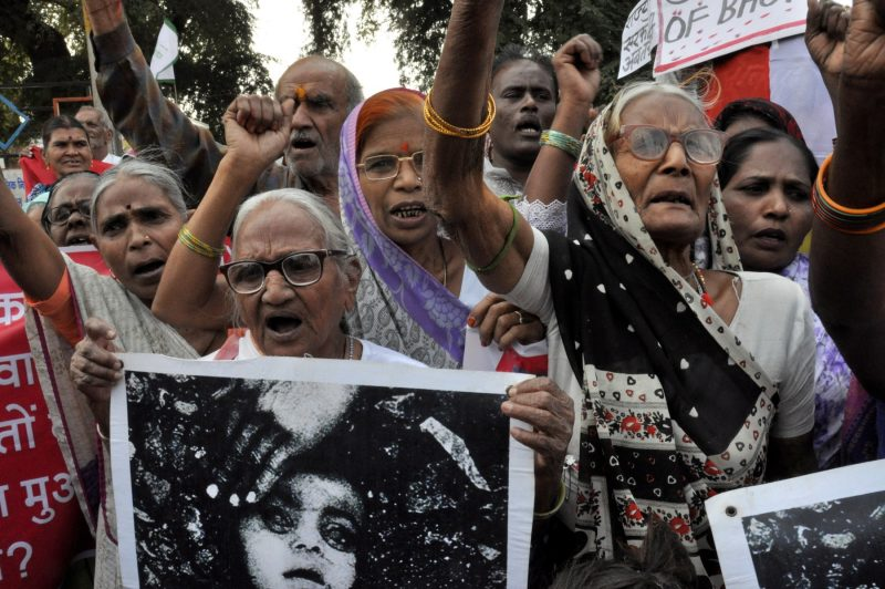 Elderly survivors of the Bhopal Disaster protest for justice and improved compensation