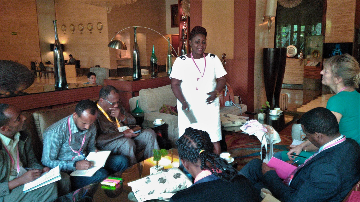 Project team members from Benin and Ethiopia sharing knowledge and discussing successes and challenges at the Organic Cotton Summit in Nagpur. Credit: PAN UK