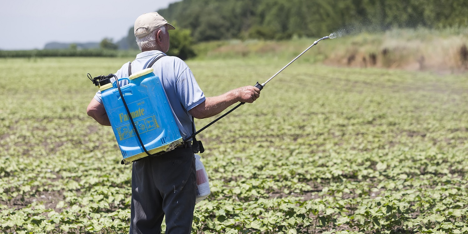 Farmer spraying pesticides on cotton in Greece - pesticide use in global cotton production