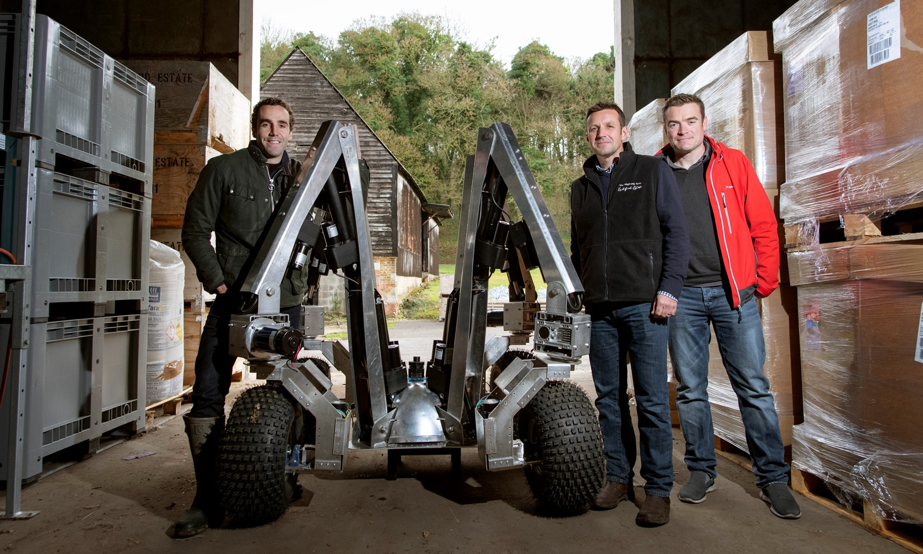 Harry prototype robot together with Sam Watson Jones, co-founder, Small Robot Company, Andrew Hoad, Partner & Head of the Leckford Estate, and Joe Allnutt, Head of Robot Awesomeness (credit Geoff Pugh)